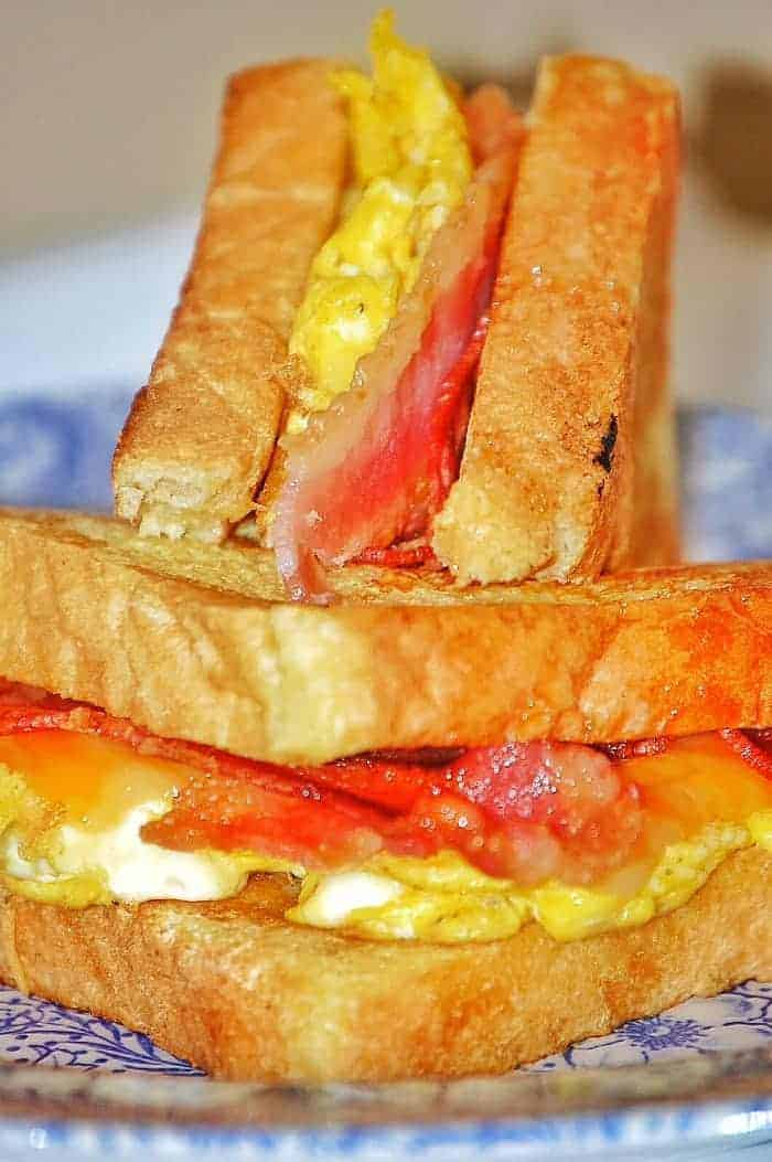 French Toast Sandwich Recipe - Voted Kid's Favorite Breakfast and easiest for moms! Bacon, Eggs, French Toast, and Cheese? Yes please! | faithfullyfree.com